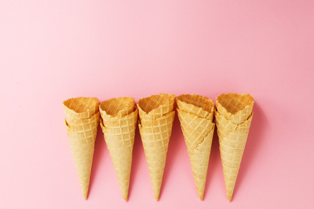 Empty Colorful Ice Cream Cones on Pink Background. Minimalism. Flat Lay.